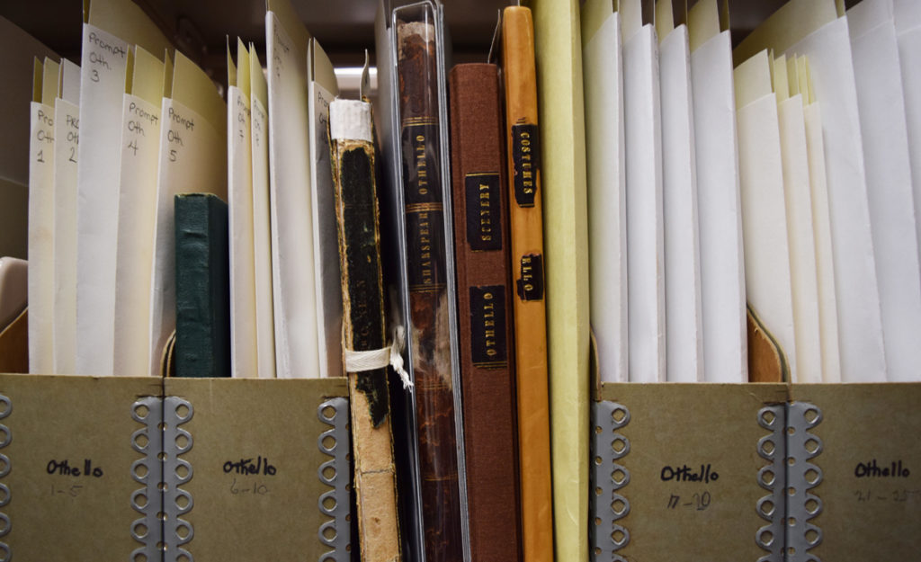 A shelf full of promptbooks for 'Othello' in the Folger vault