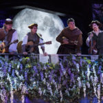 Devin Anderson (left) as Musician, Trent Dahlin as Musician, John Harrell as Amiens, and Jennifer Vosters as Musician in the Utah Shakespeare Festival's 2017 production of As You Like It. (Photo by Karl Hugh. Copyright Utah Shakespeare Festival 2017.)