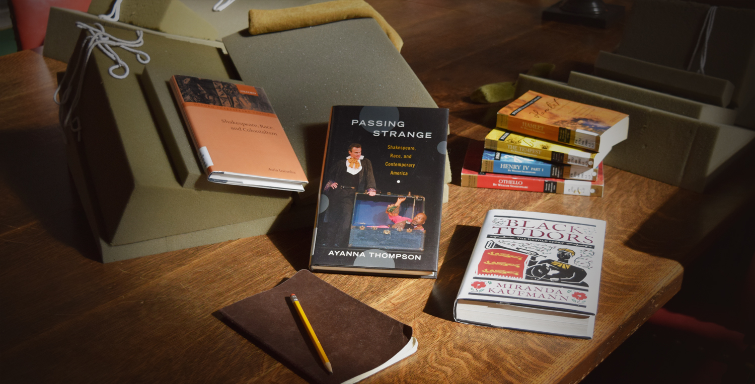 Photo of books focusing on Shakespeare and race arranged on a table