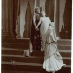 """A photograph of a 1904 production of """"The Winters Tale."""" Leontes clutches the resurrected Hermione and Perdita kneels before her."""