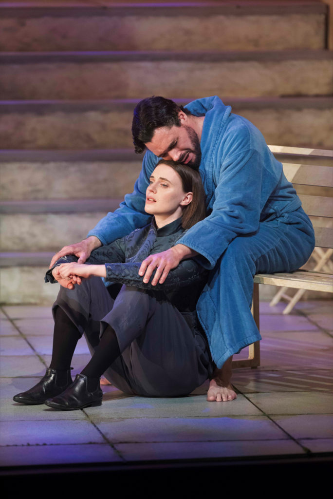 Two actors, playing Viola and Orsino in Twelfth Night, sit together.