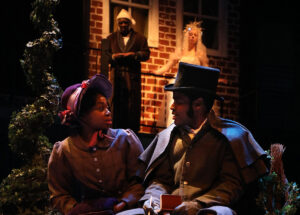"""A Christmas Carol"" at Chesapeake Shakespeare Company. Se'Lah Jackson and Terrance Fleming as Belle and Young Scrooge. Photo by Shealyn Jae."