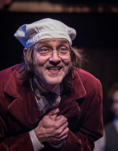 """A Christmas Carol"" at Atlanta Shakespeare Company. Drew Reeves as Ebenezer Scrooge."