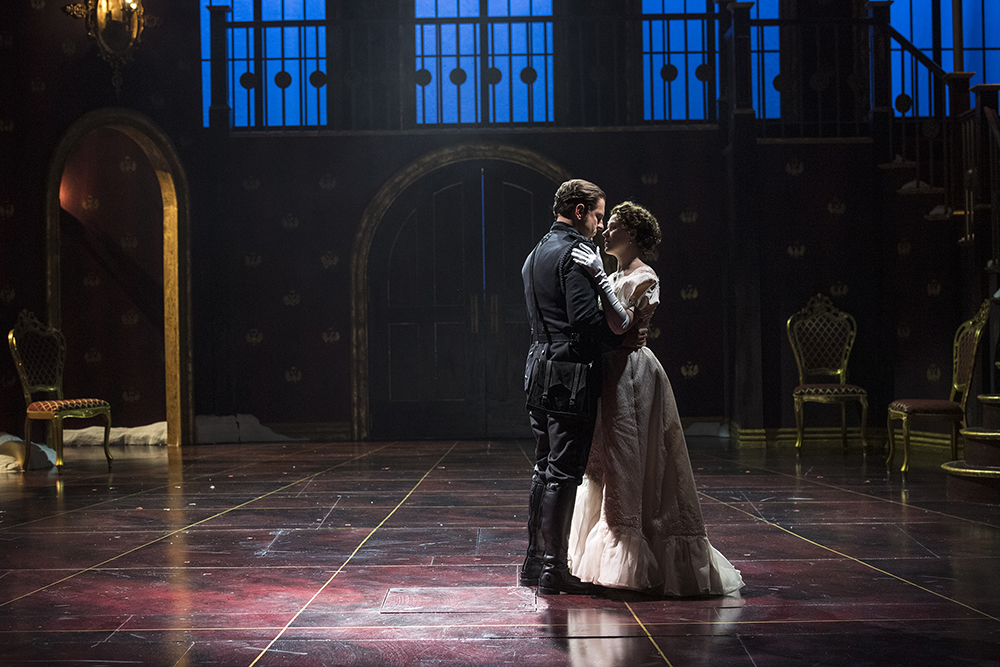 Hamlet and Ophelia embrace in the Utah Shakespeare Festival production of Hamlet.