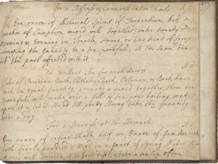 Manuscript cookbook with teaspoon and teacup